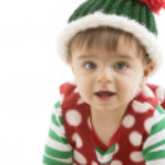 Caucasian baby boy crawls toward camera smiling — Stock Photo
