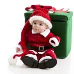 Постер, плакат: Little baby girl with a very long whimsical stocking cap