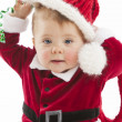 Stock Photo: Cute baby girl with blue eyes dressed up in santsuit