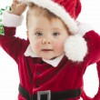Cute baby girl with blue eyes dressed up in a santa suit — Stock Photo
