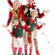 A family of christmas elves is tangled in a string of holiday lights — Stock Photo