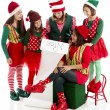 A family of Christmas elves is happy to read Santa Claus  list - Stock Photo