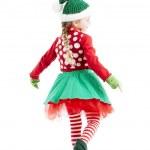 One of santas little girl christmas elves dances and twirls — Stock Photo