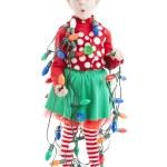 Santas helper elf tangled in a string of christmas lights — Stock Photo