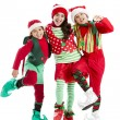 Three hispanic christmas elves dance together — Stock Photo