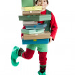Hispanic elf dances jig while carrying tall stack of christmas presents — Foto de stock #21427651