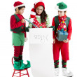 Three hispanic Christmas Elves — Stockfoto