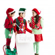 Three hispanic Christmas Elves - Stock Photo
