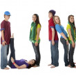Multicultural teenagers work together to form letters of alphabet with their bodies — Stock Photo #21429349