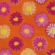 A high resolution orange, pink and yellow retro style fabric for backgrounds — Stock Photo