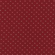A high resolution small white heart pattern printed on red fabric for backgrounds — Stock Photo