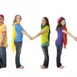 Multicultural teenagers work together to form letters of the alphabet with their bodies — Stock Photo #21429975