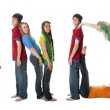 Multicultural teenagers work together to form letters of the alphabet with their bodies — Stock Photo #21429979