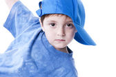 Caucasian little boy in a baseball cap with a blank expression on his face — Stock Photo