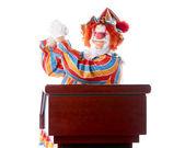 Clowns. Adult clown standing at a podium giving a speech — Stock Photo