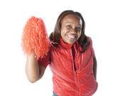 Sportfantaster. svart kvinna fan jublar med en pom pom — Stockfoto