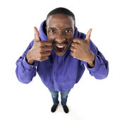 Fisheye caricature of an elated teenage boy giving two thumbs up — Stock Photo