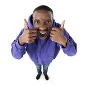 Fisheye caricature of an elated teenage boy giving two thumbs up — Stock Photo