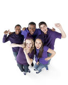 Sports Fans. Group of smiling teenagers standing together as friends for the purple team — Stok fotoğraf