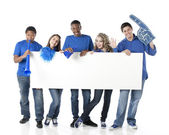 Sports Fans. Group of smiling teenagers cheering together as friends for the blue team — Stock Photo