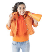 Sports Fans. Smiling teenage girl fan cheering with a megaphone — Stock Photo