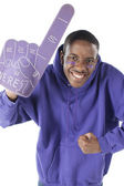 Sports Fans. African american male sports fan roots for the purple team with foam finger and face paint. — Stock Photo