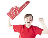 Sports Fans. Caucasion male sports fan roots for the red team with foam finger and face paint — Stock Photo
