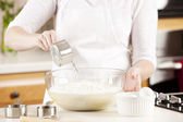 Baking. A chef mixes the ingredients for the batter of a delicious dessert cake — Stock Photo