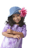 Smiling little girl with long hair and a purple shirt — Stock Photo