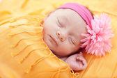 Sleeping caucasian newborn baby girl — Stock Photo