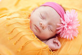 Sleeping caucasian newborn baby girl — Stock Photo