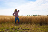 A hardworking female farmer looks out — Foto Stock
