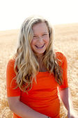 A midwestern farm girl laughs — Stock Photo