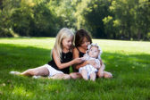 Young sisters in park — Stock Photo