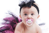 Closeup of a 7 month old spoiled caucasian baby girl — Stock Photo