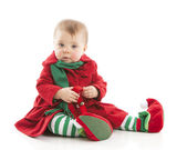 A cute baby girl plays with jingle bells — Stock Photo