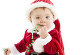 Funny baby girl eats christmas ribbon — Stock Photo