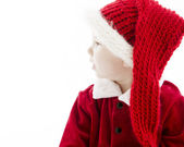 Profile of little baby boy dressed as santa claus. — Stock Photo