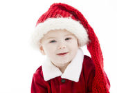 Teething baby boy dressed as santa claus — Stock Photo