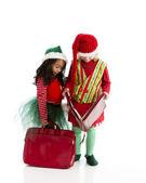Two of santas accounting christmas elves pretend to strutinize the ledger — Stock Photo