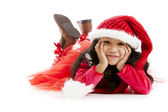 Mixed race little girl dressed like santa daydreams about christ — Stockfoto