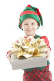 One of santas helper elves extends a beautifully wrapped christmas present — Stock Photo
