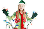 Santas christmas elf tangled in holiday lights — Stock Photo