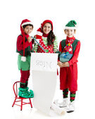 Three hispanic Christmas Elves — Stock Photo