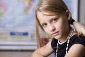 Caucasian little girl in the school classroom — Stock Photo