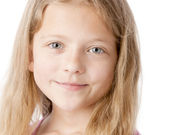 A clsoeup headshot of a smiling caucasian 9 year old little real girl — Stock Photo