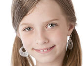 A closeup headshot of a smiling caucasian 7 year old little real girl — Stock Photo