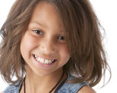 A closeup headshot of a smiling mixed race girl — Stock Photo