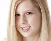 A closeup headshot of a smiling caucasian 16 year old teenage real girl — Stock Photo