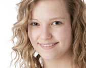 A closeup headshot of a smiling caucasian 14 year old teenage real girl. — Stock Photo